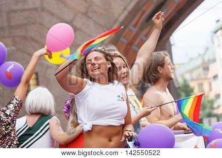 STOCKHOLM SWEDEN - JUL 30 2016: Dancing and singing girls and boys in the Pride parade July 30 2016 in Stockholm Sweden