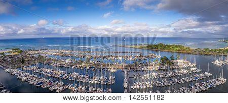 Panoramic view of the Ala Wai Boat Harbor and Magic Island Lagoon in Honolulu, Hawaii.