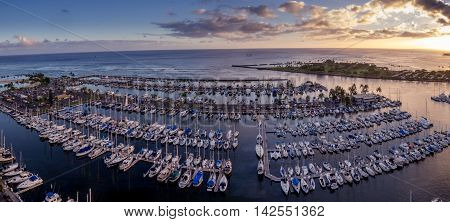 Panoramic view of the Ala Wai Boat Harbor and Magic Island Lagoon in Honolulu, Hawaii at sunset.