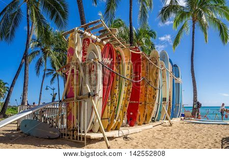 HONOLULU, USA - AUG 4: Surf rental shop on Waikiki beach on August 4, 2016 in Honolulu, Usa. Waikiki beach is neighborhood of Honolulu, best known for white sand and surfing.
