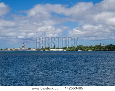 OAHU, HI - AUG 5, 2016: USS Missouri and Arizona memorials on August 5, 2016 in Pearl Harbor, USA. Site of the treaty signing ending WWII between the US and Japan, is now berthed in Pearl Harbor.