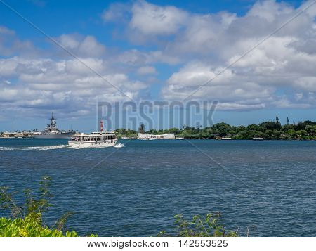 OAHU, HI - AUG 5, 2016: Ferry travelling to the USS Arizona Memorial on August 5, 2016 in Pearl Harbor, USA. Memorial marks resting place of sailors who died when the USS Arizona was sunk by Japan.