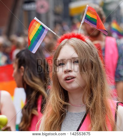 STOCKHOLM SWEDEN - JUL 30 2016: Young girl wearing with rainbow pride flags in her hair in the Pride parade July 30 2016 in Stockholm Sweden