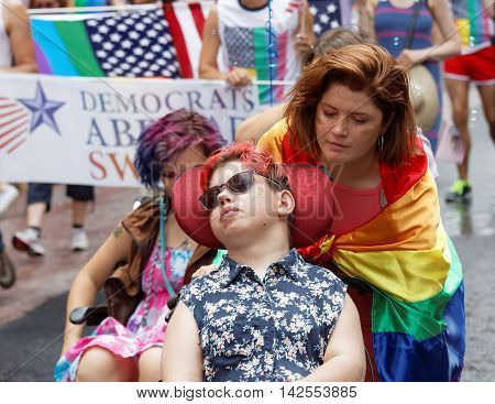 STOCKHOLM SWEDEN - JUL 30 2016: Boys and girls in wheel chair in the Pride parade July 30 2016 in Stockholm Sweden
