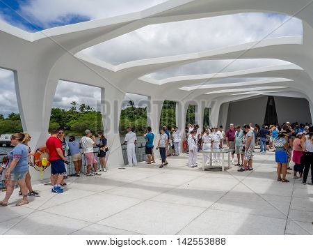 OAHU, HI - AUG 5, 2016: People visit USS Arizona Memorial on August 5, 2016 in Pearl Harbor, USA. Memorial marks resting place of sailors and Marines who died when the USS Arizona was sunk by Japan.