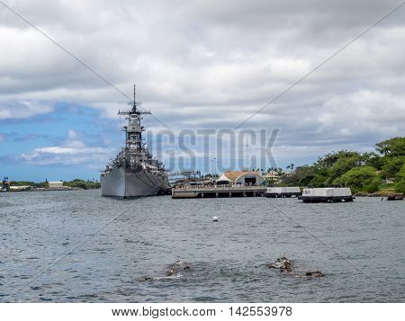 OAHU, HI - AUG 5, 2016: USS Missouri battleship museum and USS Arizona Memorial on August 5, 2016 in Pearl Harbor, USA. Site of the treaty signing ending WWII between the US and Japan, is now berthed in Pearl Harbor Hawaii.