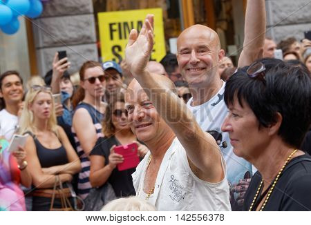 STOCKHOLM SWEDEN - JUL 30 2016: The swedish writer and comedian Jonas Gardell his man Mark Levengood and the politician Mona Sahlin in the Pride parade July 30 2016 in Stockholm Sweden