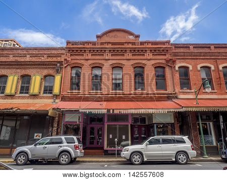 HONOLULU, HI - AUG 6: View of heritage buildings in Chinatown on August 6, 2016 in Honolulu, Hawaii. The busy Chinatown district is popular for tourists visiting the city and waikiki.