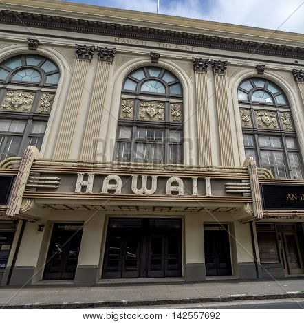 HONOLULU, HI - AUG 6: View of the facade of the historic Hawaii State Theater on August 6, 2016 in Honolulu, Hawaii. It is located in Chinatown and is popular for residents and tourists.