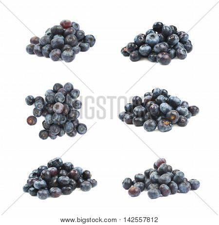 Pile of ripe bilberries isolated over the white background, set of six different foreshortenings