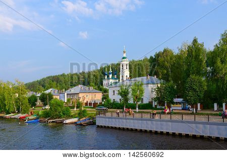 PLES RUSSIA - JULY 20 2016: Unidentified people walk on promenade near river quay of small provincial town of Ples Russia