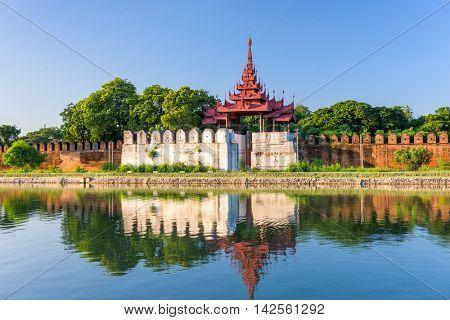 Mandalay, Myanmar at the palace wall and moat.