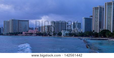Famous Waikiki Beach on the Hawaiian island of Oahu at dusk.