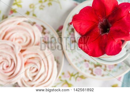 Meringue Cakes In The Form Of Roses In A Romantic Dish With Red Flower