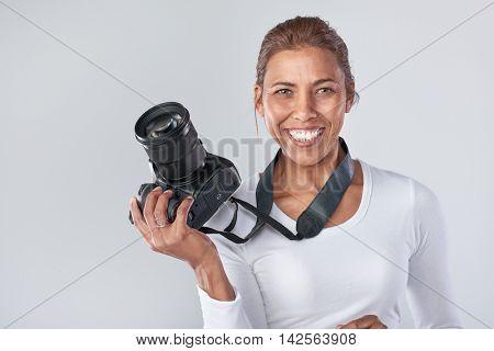 Confident woman holding dslr camera, professional photographer