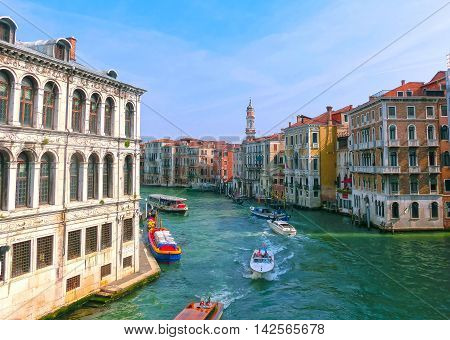 Venice, Italy - May 10, 2014: Beautiful view from Grand Canal on colorful facades of old medieval houses in Venice, Italy at sunset