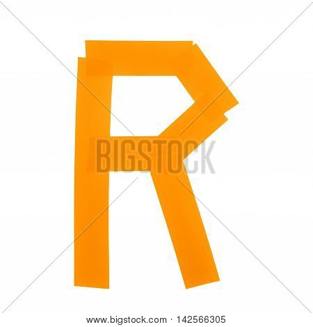 Letter R symbol made of insulating tape pieces, isolated over the white background
