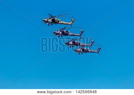 August 6 2016. Ryazan Russia. The helicopters of the Military Air forces of Russia perform aerobatics at an Airshow. Documentary Editorial Image.