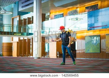 BANGKOK THAILAND – August 142016: Trainer boy playing pokemon pokemon ball playing at Gym Pokemon location Lighting with sun flare