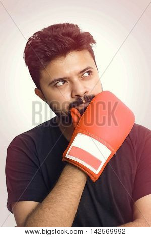 Young Men Wearing Black T Shirt Looking Up And Thinking Wearing Red Hot Boxing Gloves