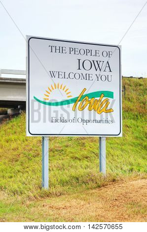 The People of Iowa Welcome You sign at the state border