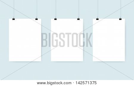 Three blank white poster with binder clips. Mockup design. Vector illustration.