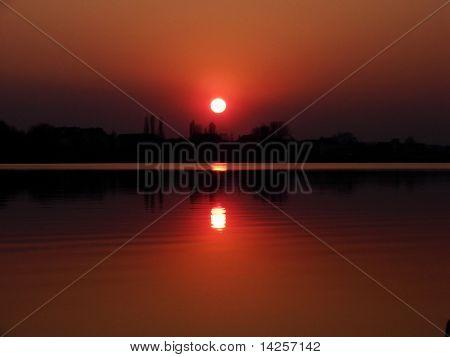 Beautiful sunset above  lake