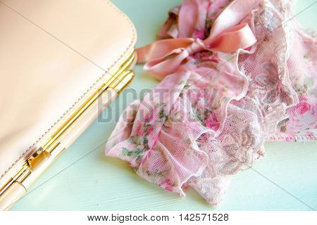 Sexy lingerie and a handbag on wooden background. Sexy lace underwear. the concept of the sexual life of women, casual relationships, relationship with a man. safe sex being a mistress