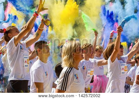 Ukraine, Kyiv - 08/14/2016.  Kyiv color run. Run 5 km from the colors of Holi. People keep and throw holy colors.