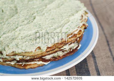 Layer a Cake a Zucchini and mayonnaise.