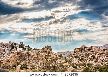 Stormy clouds with sun rays at Joshua Tree National Park, California