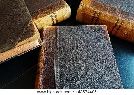Old books with textured weathered leather covers