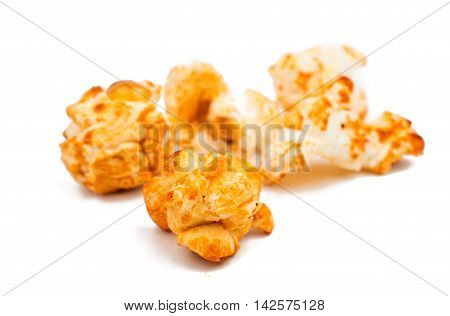 golden sweet popcorn on a white background