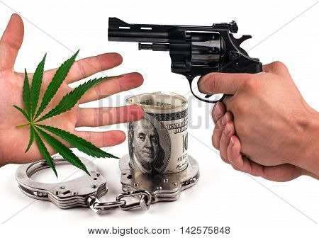 gun handcuffs marijuana and dollars isolated. the concept of crime