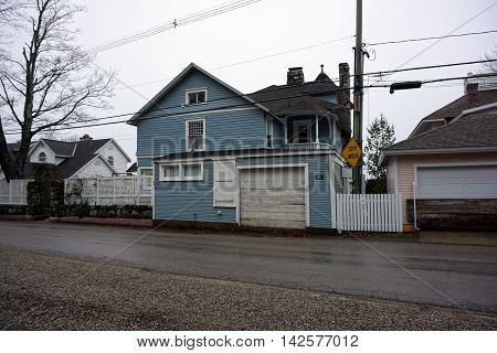 WEQUETONSING, MICHIGAN / UNITED STATES - DECEMBER 22, 2015: A large blue mansion on Beach Drive in Wequetonsing.