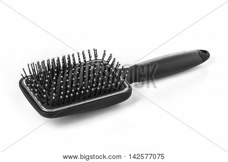 Hair brush with a black handle isolated on white