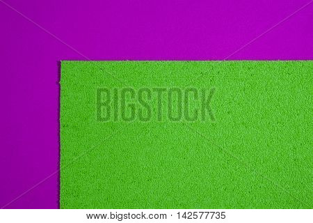 Eva foam ethylene vinyl acetate sponge plush apple green surface on pink smooth background