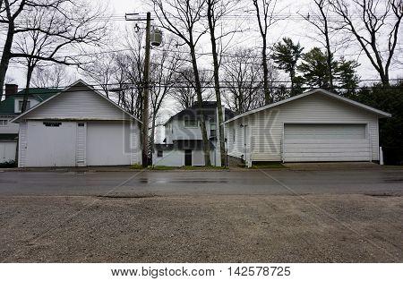 WEQUETONSING, MICHIGAN / UNITED STATES - DECEMBER 22, 2015: The garages of homes on Beach Road in Wequetonsing, Michigan.