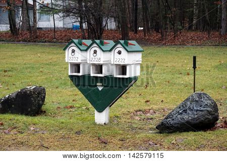 WEQUETONSING, MICHIGAN / UNITED STATES - DECEMBER 22, 2015: The mailboxes of three homes in Wequetonsing, Michigan.