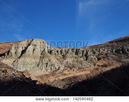 The amazing hills of Oregon's John Day Fossil Beds receive their first light of the day giving them a green color.