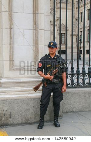 Lima, Peru-january 31: Unidentified Policeman Stands Near Government Palace During Festival Of The V