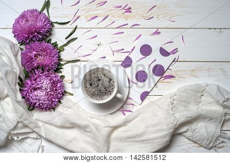Word relax with cup of coffee and pink flowers. Copy space for text. greeting card