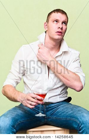 Handsome Man Sitting With Glass Of Alcohol