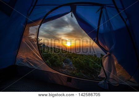 Dawn of the tent on the top of mountain Chitinza