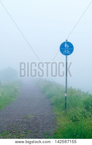 Traffic sign pedestrians and cyclists in fog