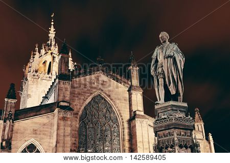 St Giles' Cathedral with Duke of Buccleuch (Walter Scott) statue as the famous landmark of Edinburgh. United Kingdom.