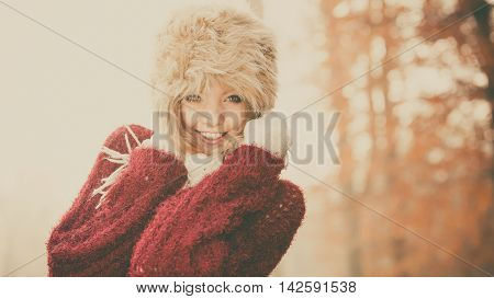 Portrait Of Pretty Smiling Woman In Fur Winter Hat
