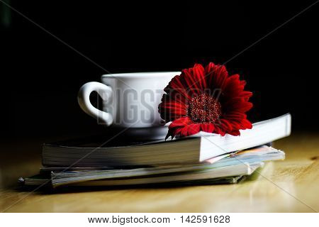 elax in the garden - coffee book and red flower