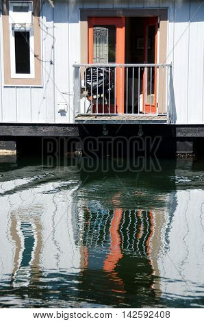 Reflections In Float House Village In Victoria -3