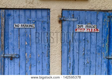 Bilingual No Parking Sign In English And Welsh On Garage Doors